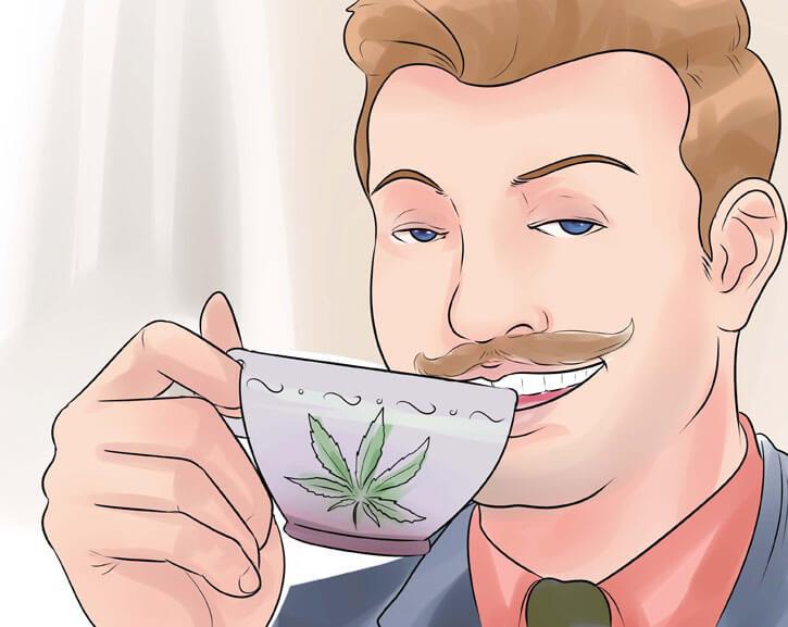 мужчина пьет из чашки